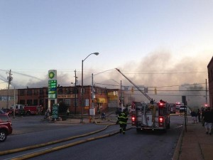 Firefighters fighting a fire in Remington