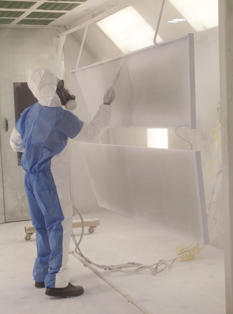Dennis powder coating the panels