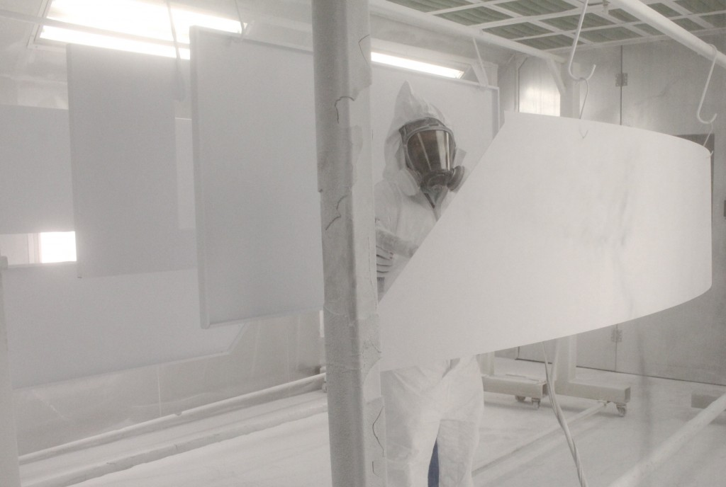 Dennis powder coating the panels 3